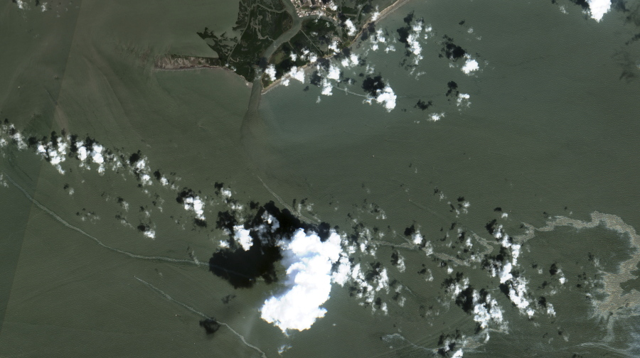 In a satellite image provided by Maxar Technologies, an oil slick is shown on Sept. 2, 2021 south of Port Fourchon, La.  The U.S. Coast Guard said Saturday, Sept. 4,  that cleanup crews are responding to a sizable oil spill in the Gulf of Mexico following Hurricane Ida.