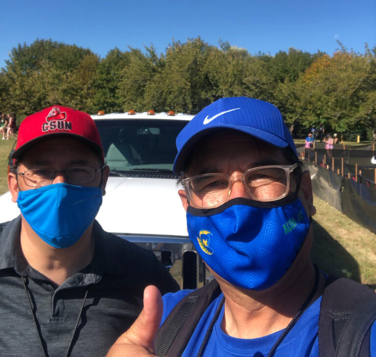 Columbian reporter Tim Martinez (left) with his much-older brother Ken Martinez, the longtime cross country coach at Aloha High School in Beaverton, Ore.