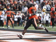 Oregon State running back B.J. Baylor (4) strides in to the end zone for a touchdown during the first half of an NCAA college football game against Idaho on Saturday, Sept. 18, 2021, in Corvallis, Ore.