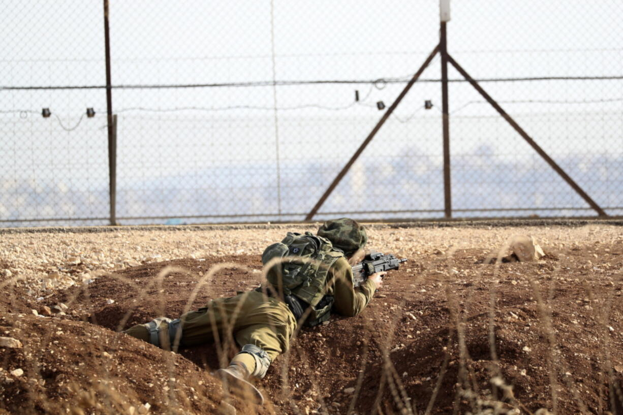 An Israeli soldier takes position along the border between the northern West Bank near Jenin and Israel as they search for two Palestinians who broke out of a maximum-security prison last week, on a road leading to the West Bank town of Jenin, near Gan Ner Israel, Sunday, Sept. 12, 2021. Israeli police on Saturday said they arrested four of the six Palestinians who broke out of the prison including Zakaria Zubeidi a famed militant leader whose exploits over the years have made him a well-known figure in Israel.