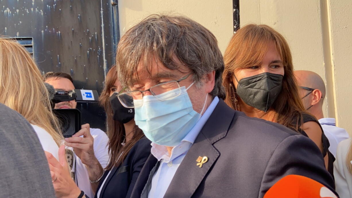 Catalan leader Carles Puigdemont, leaves the jail of Sassari, in Sardinia, Italy, Friday, Sept. 24, 2021. Puigdemont, sought by Spain for a failed 2017 secession bid, on Friday was released following a court hearing, ahead of an Italian court decision on Spain's extradition request, a day after Italian police detained him in Sardinia, an Italian island with strong Catalan cultural roots and its own independence movement.