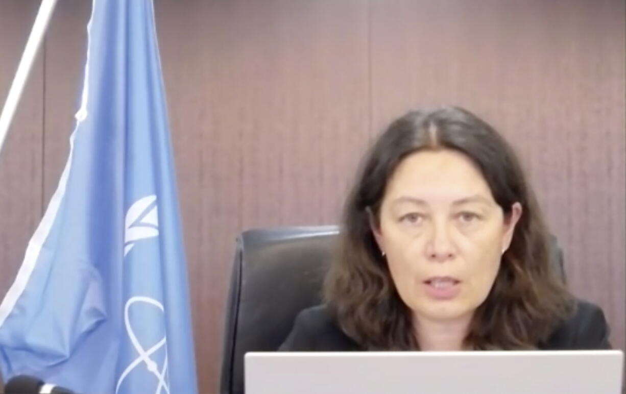 In this image made from video, head of the International Atomic Energy Agency Lydie Evrad, speaks to media via video conference concerning the Fukushima Daiichi nuclear power plant, damaged in the massive earthquake and tsunami in 2011, Thursday, Sept. 9, 2021. The three-member team led by Evrard, is in Japan for a five-day visit for a preliminary talks and visit to the nuclear power plant to prepare for the IAEA's multi-year monitoring and review of the planned water discharge, which is expected to take decades.