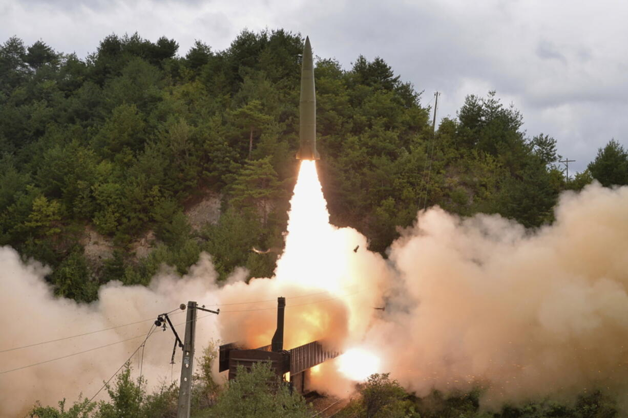 FILE - In this Sept. 15, 2021, file photo provided by the North Korean government, Sept. 16, 2021, shows a test missile is launched from a train, in an undisclosed location of North Korea. Recent satellite images shows North Korea is expanding a uranium enrichment plant at its main Yongbyon nuclear complex, a sign that it's intent on boosting the production of bomb materials, experts say. The assessment comes after North Korea recently raised tensions by performing its first missile tests in six months amid long-dormant nuclear disarmament diplomacy with the United States. Independent journalists were not given access to cover the event depicted in this image distributed by the North Korean government. The content of this image is as provided and cannot be independently verified.