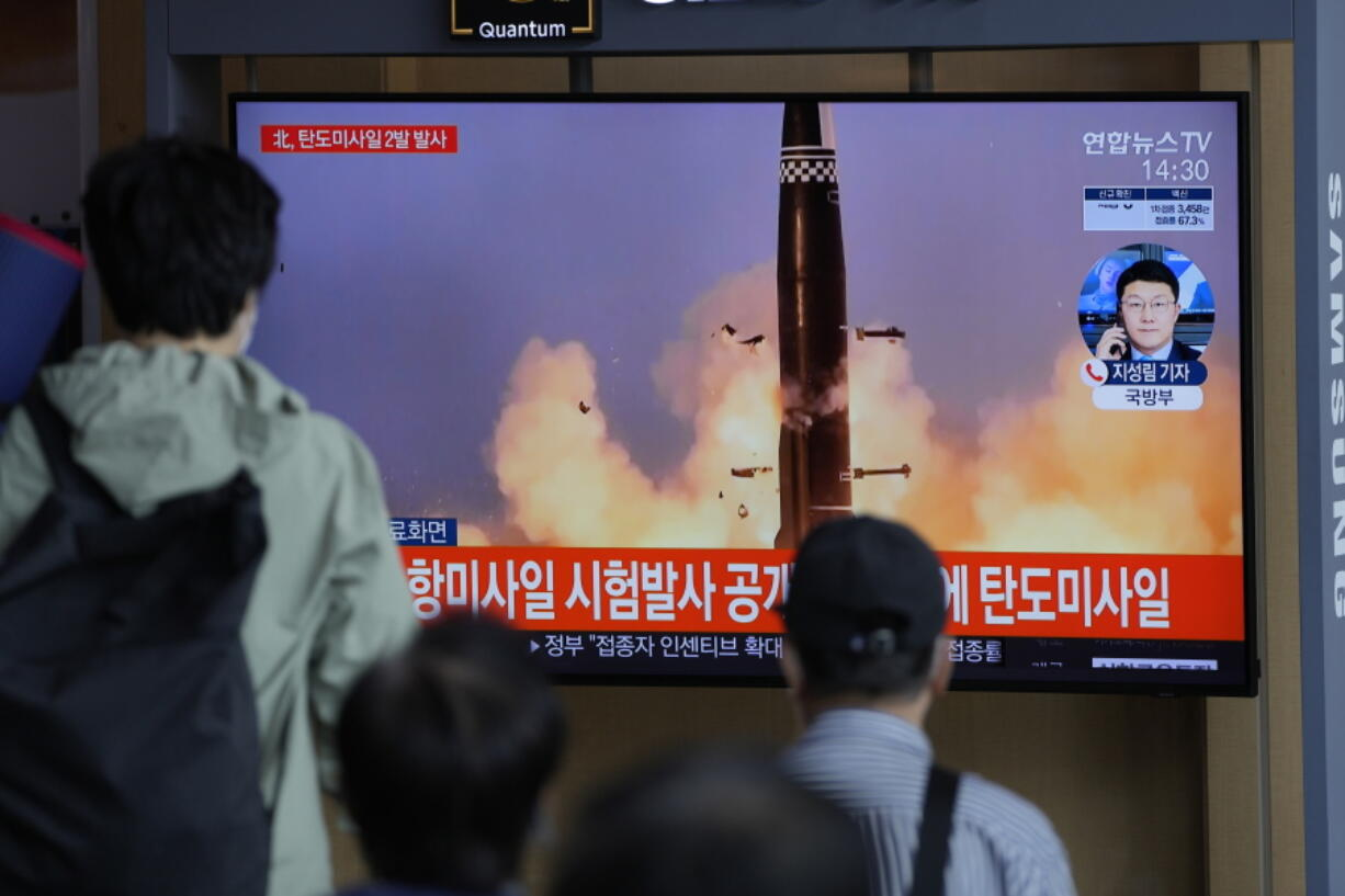 People watch a TV screen showing a news program reporting about North Korea's missiles with file image in Seoul, South Korea, Wednesday, Sept. 15, 2021. North Korea fired two ballistic missiles into waters off its eastern coast Wednesday afternoon, two days after claiming to have tested a newly developed missile in a resumption of its weapons displays after a six-month lull.