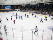 Seattle Kraken players and coaches workout during NHL hockey training camp at Kraken Community Iceplex on Thursday, Sept. 23, 2021, in Seattle.