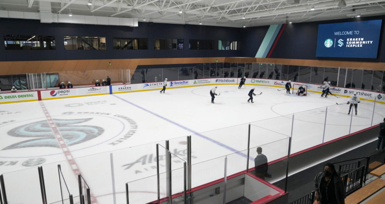 Seattle Kraken players take part in a practice session, Thursday, Sept. 9, 2021, during a media event for the grand opening of the Kraken's NHL hockey practice and community facility in Seattle. (AP Photo/Ted S.