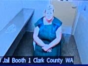 Lani Kraabell, 48, of Winlock makes a first appearance Monday morning, Sept. 13, 2021, in Clark County Superior Court on suspicion of second-degree murder, possession of a stolen firearm and second-degree unlawful possession of a firearm. She is accused of facilitating the sale of stolen firearms linked to an undercover investigation that led to the fatal shooting of Clark County sheriff's Detective Jeremy Brown.