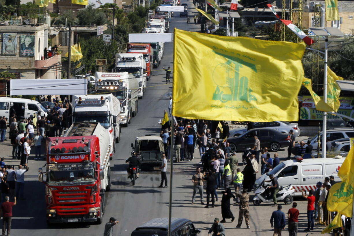 A convoy of tanker trucks carrying Iranian diesel crossed the border from Syria into Lebanon, arrive at the eastern town of el-Ain, Lebanon, Thursday, Sept. 16, 2021. The delivery, organized by the Iranian-backed Hezbollah group, violates U.S. sanctions imposed on Tehran after former President Donald Trump pulled America out of a nuclear deal between Iran and world powers three years ago.