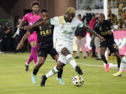 Portland Timbers forward Dairon Asprilla controls the ball in front of a Los Angeles FC defender during the first half of an MLS soccer match Wednesday, Sept. 29, 2021, in Los Angeles.