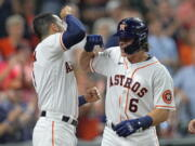 Houston Astros' Jake Meyers (6) celebrates with Carlos Correa after hitting a three-run home run against the Seattle Mariners during the second inning of a baseball game Monday, Sept. 6, 2021, in Houston. (AP Photo/David J.