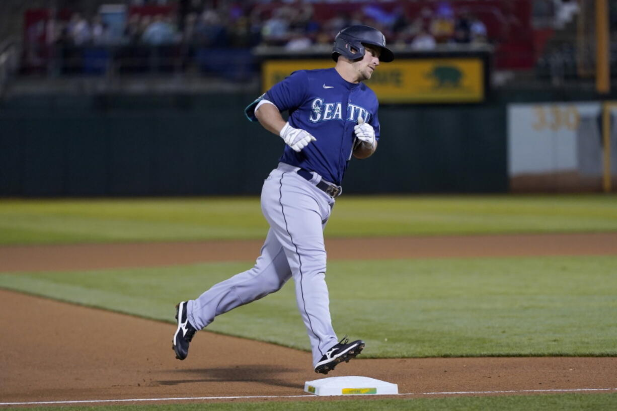 Seattle Mariners' Kyle Seager rounds the bases after hitting a home run against the Oakland Athletics during the fourth inning of a baseball game in Oakland, Calif., Wednesday, Sept. 22, 2021.