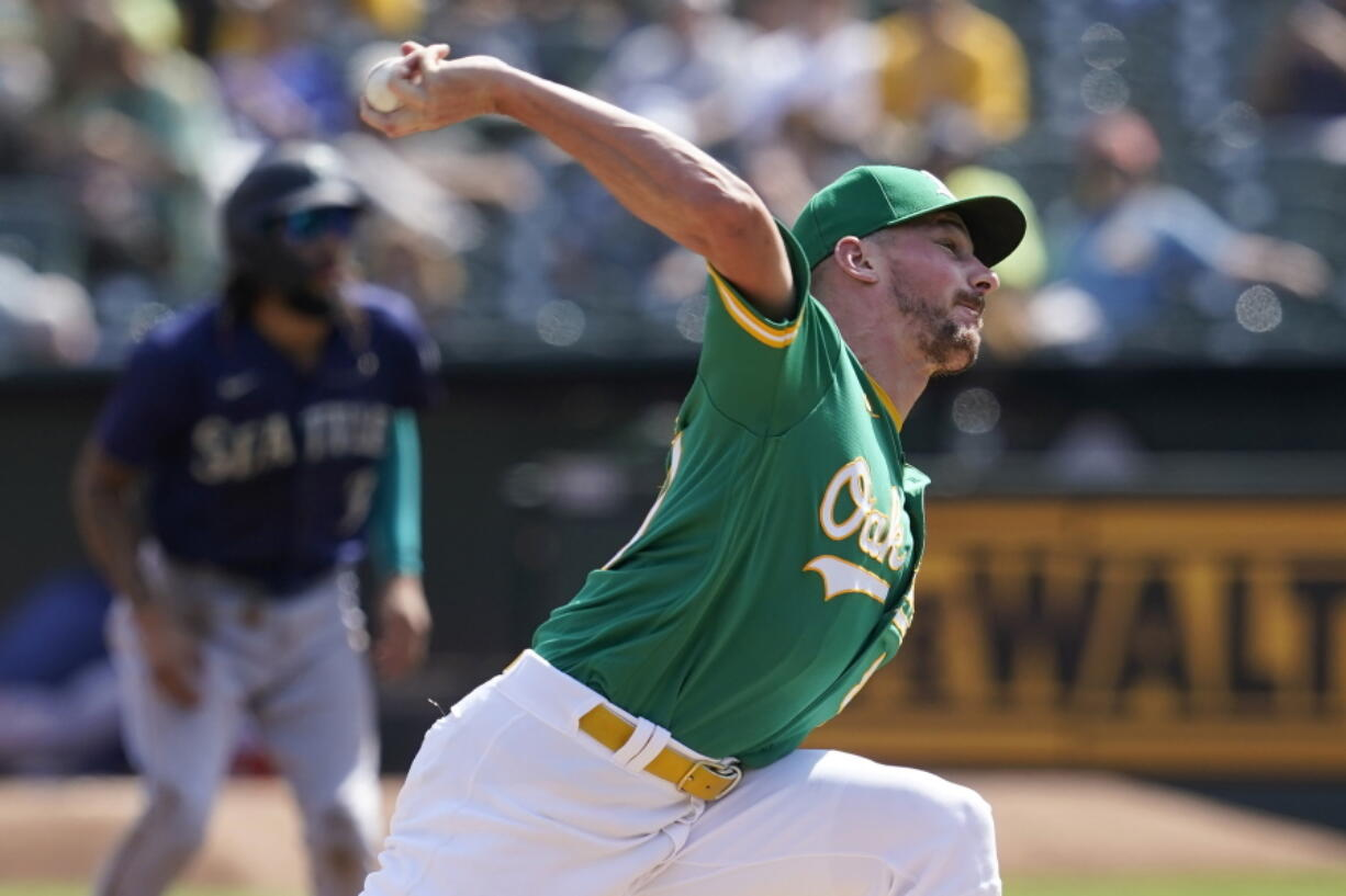 Oakland Athletics' Chris Bassitt pitches against the Seattle Mariners during the first inning of a baseball game in Oakland, Calif., Thursday, Sept. 23, 2021.