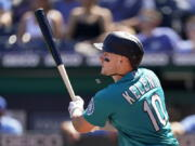 Seattle Mariners' Jarred Kelenic hits a two-run double during the first inning of a baseball game against the Kansas City Royals Sunday, Sept. 19, 2021, in Kansas City, Mo.