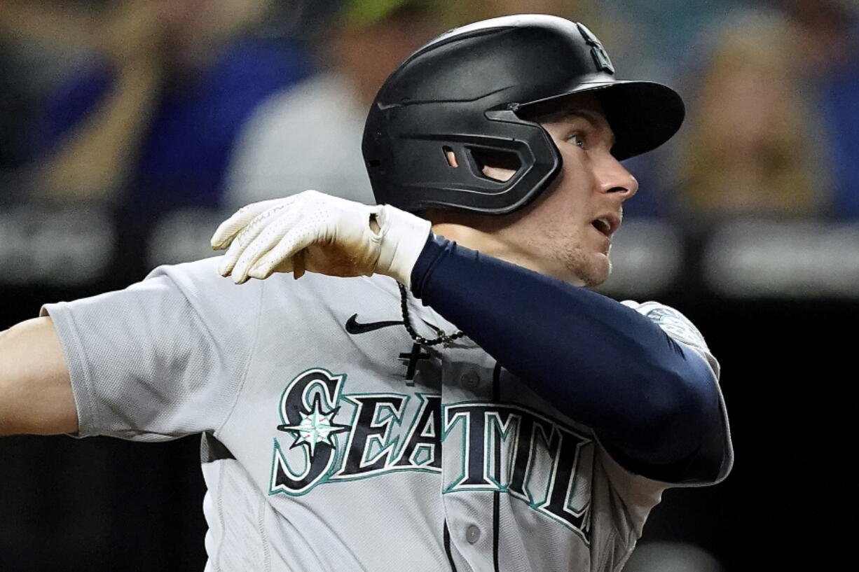 Seattle Mariners' Jarred Kelenic watches his two-run home run during the fourth inning of a baseball game against the Kansas City Royals Friday, Sept. 17, 2021, in Kansas City, Mo.