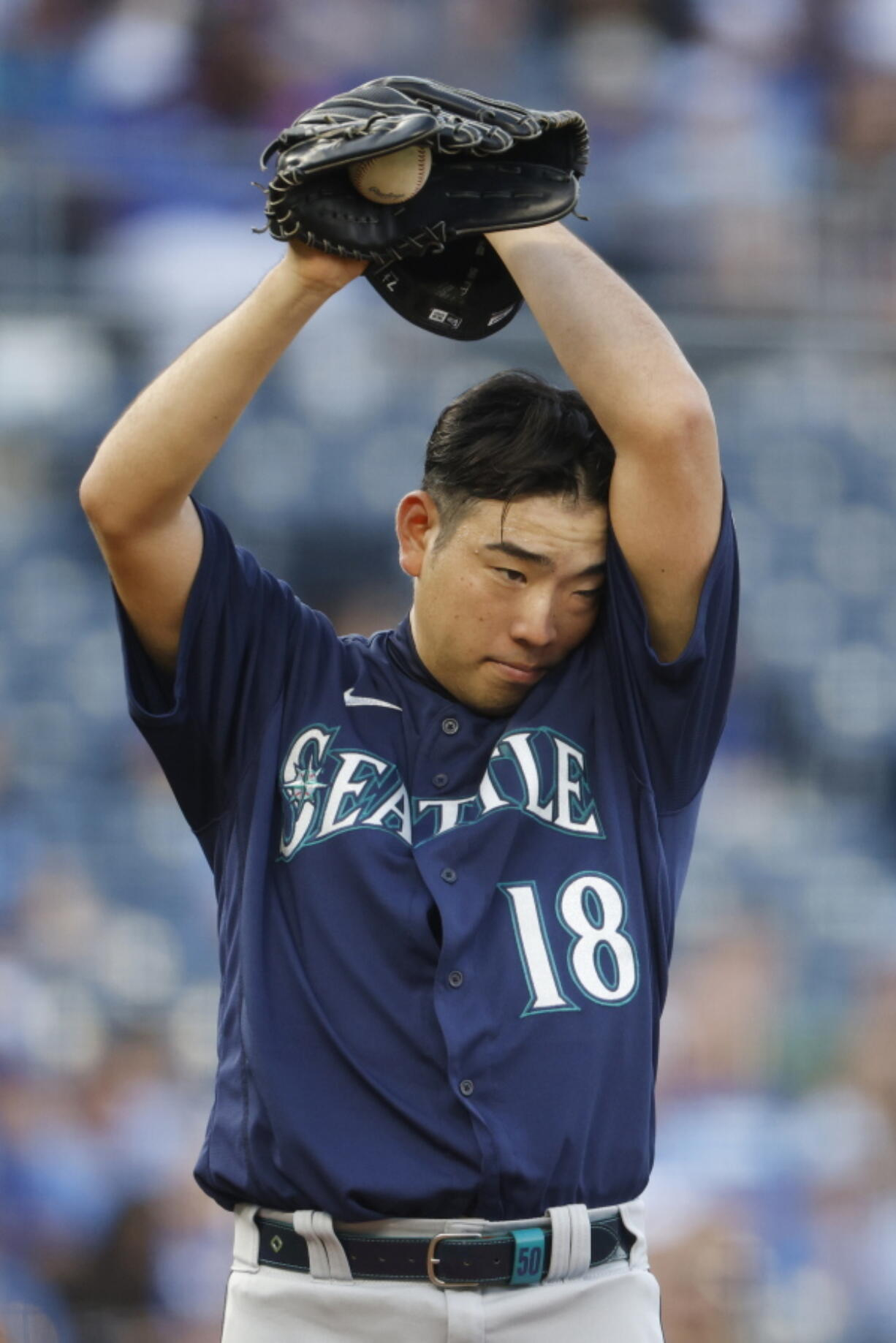 Seattle Mariners pitcher Yusei Kikuchi wipes sweat from his brow during the first inning of a baseball game against the Kansas City Royals at Kauffman Stadium in Kansas City, Mo., Saturday, Sept. 18, 2021. (AP Photo/Colin E.
