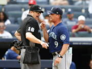 Seattle Mariners manager Scott Servais (9) argues with umpire Lance Barrett (16) before being ejected during the eighth inning of a baseball game against the New York Yankees, Sunday, Aug. 8, 2021, in New York. (AP Photo/Noah K.