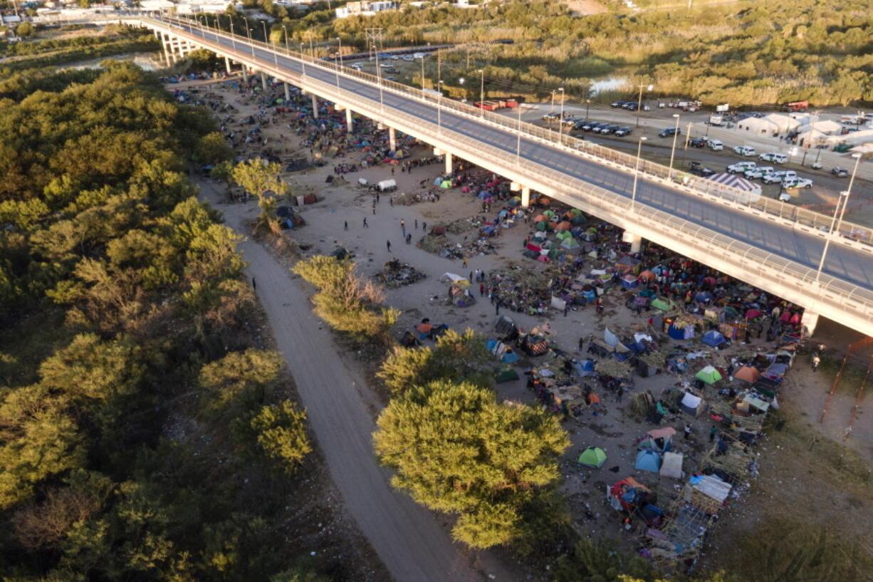 Migrants, many from Haiti, are seen in an encampment along the Del Rio International Bridge near the Rio Grande, Thursday, Sept. 23, 2021, in Del Rio, Texas.