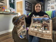 Seraphine Warren poses for a photo in her home in Tooele, Utah, on Sept. 23, 2021, with a rug made by her aunt, Navajo rug weaver Ella Mae Begay. Begay, 62, disappeared in June, one of thousands of missing Indigenous women across the U.S. The extensive coverage of the Gabby Petito case is renewing calls to also shine a spotlight on missing people of color.