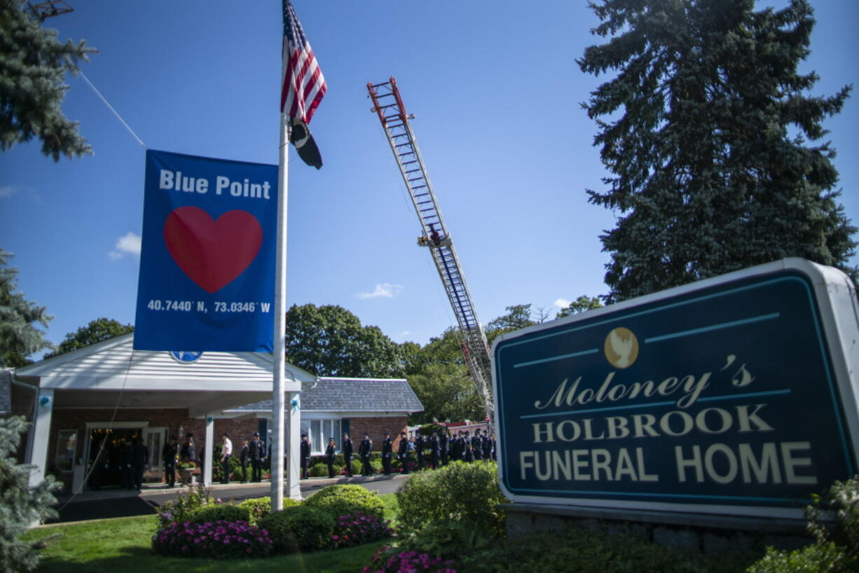 Long Island firefighters attend the funeral service of Gabby Petito at Moloney's Holbrook Funeral Home in Holbrook, N.Y. Sunday, Sept. 26, 2021.