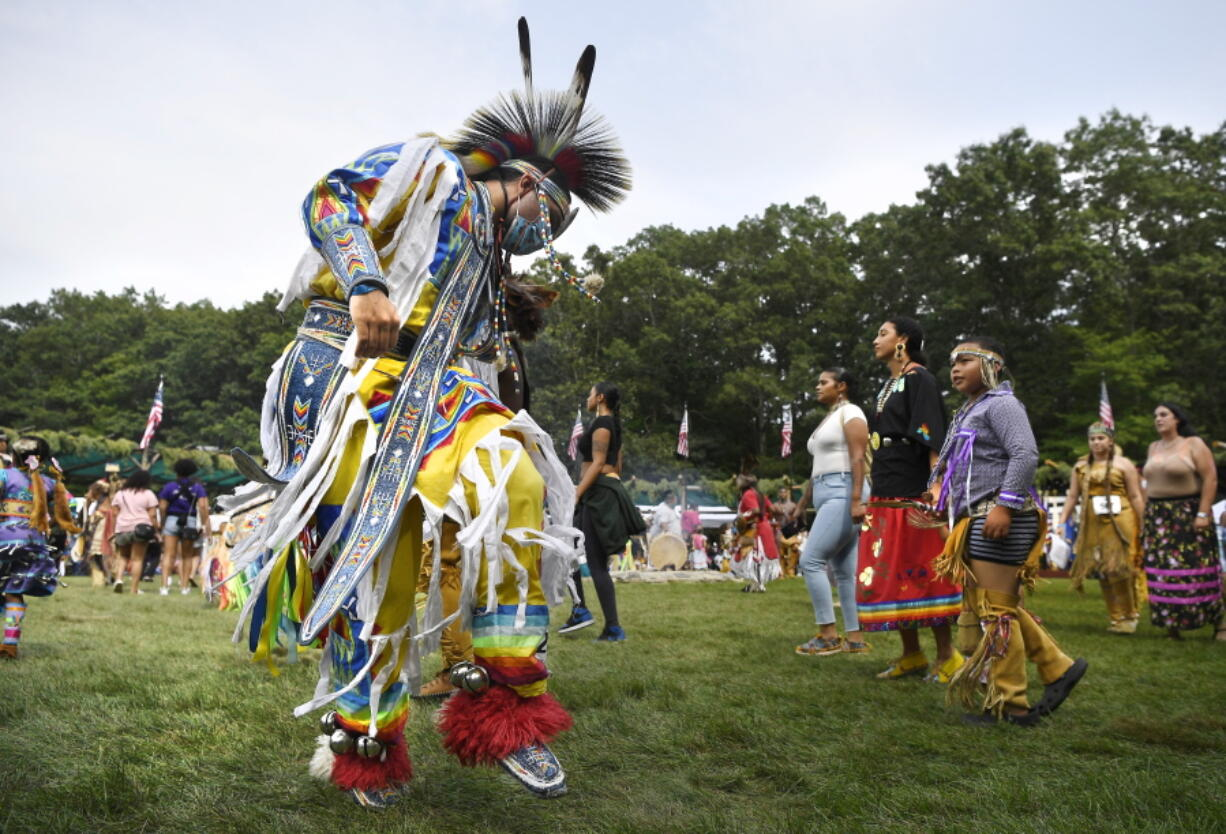 A dancer participates in an intertribal dance at Schemitzun on the Mashantucket Pequot Reservation in Mashantucket, Conn., Saturday, Aug. 28, 2021. Connecticut and a handful of other states have recently decided to mandate students be taught about Native American culture and history.