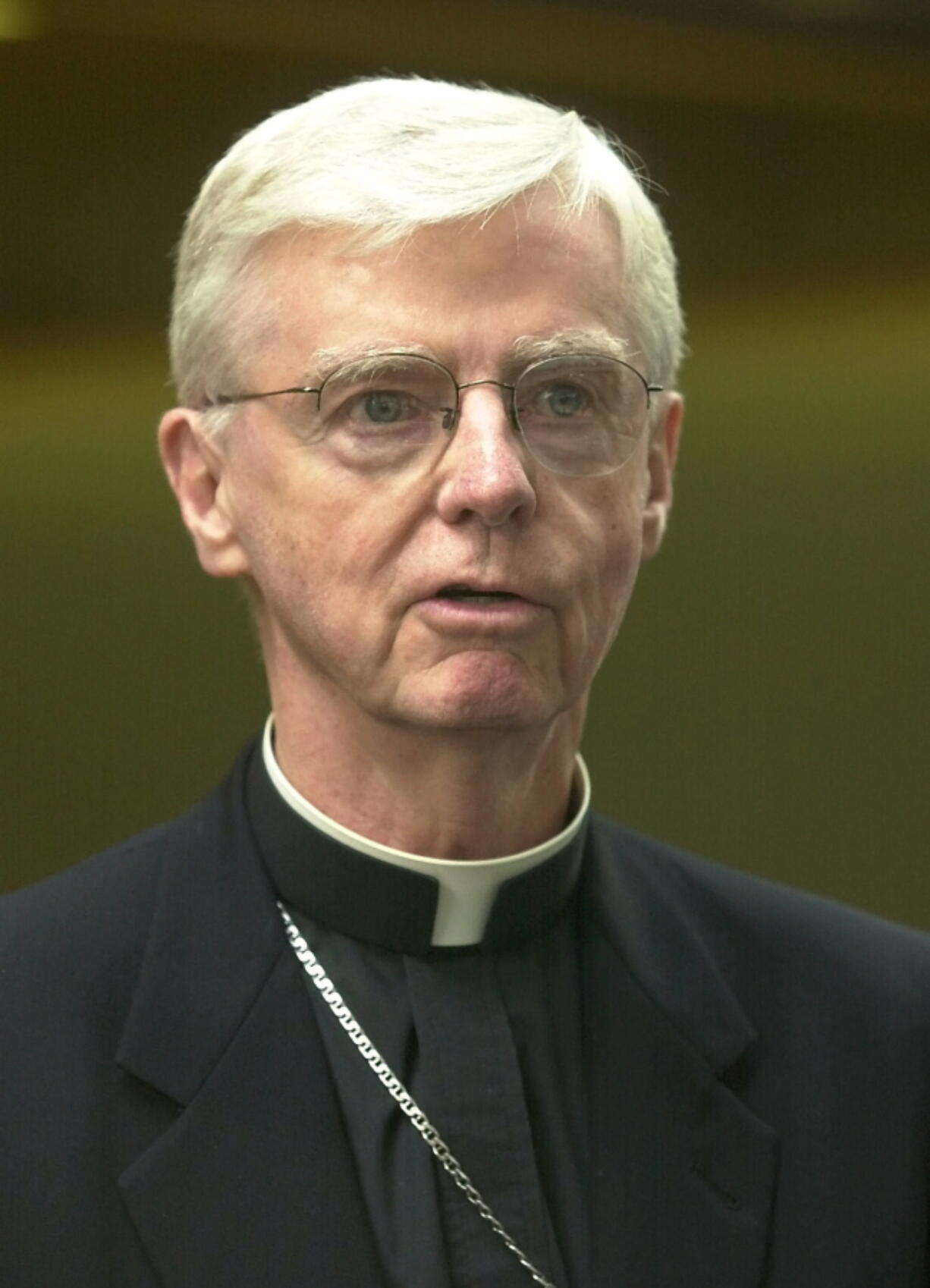 FILE -- New Hampshire Bishop John McCormack speaks to reporters, in Manchester, N.H., in this Thursday, Aug. 15, 2002 file photo. McCormack, who faced criticism for his role in Boston's clergy sex abuse scandal and led New Hampshire's diocese during its own reckoning, has died. McCormack, 86, died Tuesday, Sept. 21, 2021, at Mt. Carmel Rehabilitation and Nursing Center in Manchester, according to the Diocese of Manchester.