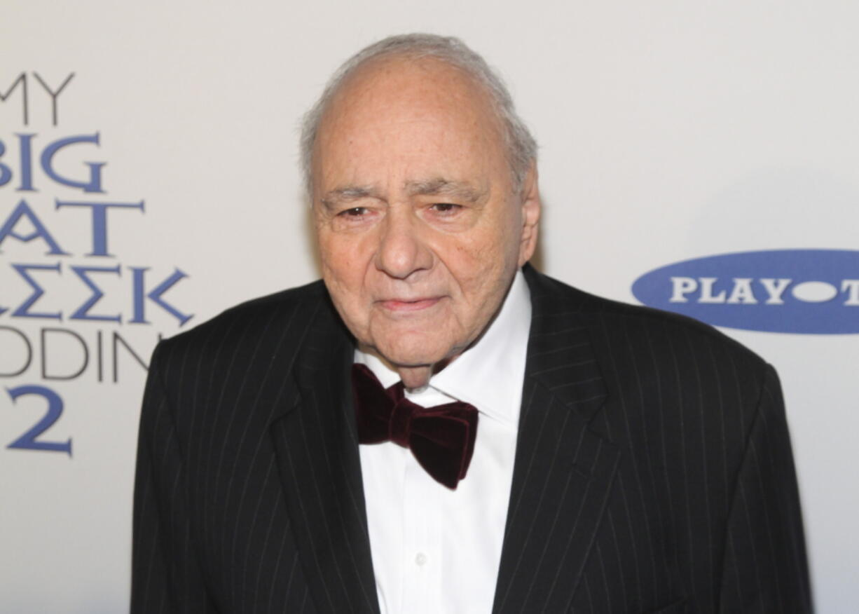 """FILE - Michael Constantine attends the premiere of """"My Big Fat Greek Wedding 2""""in New York on March 15, 2016. Constantine, an Emmy Award-winning character actor who reached worldwide fame playing the Windex bottle-toting father of the bride in the 2002 film """"My Big Fat Greek Wedding,"""" died Aug. 31 in his home at Reading, Pennsylvania, of natural causes. He was 94."""