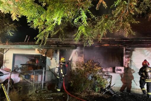 A house in the Orchards neighborhood caught fire early Saturday morning, and firefighters found a woman dead inside the house.
