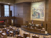 A handful of senators talk on the floor of the Oregon State Senate on Monday, Sept. 20, 2021, as the Oregon Legislature conducted a special session to consider redistricting. The aim of the session is to pass new legislative and congressional district maps which the state will use for elections.
