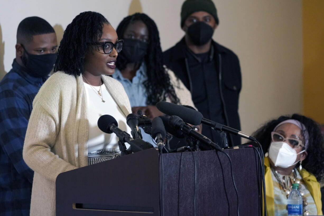 """FILE - In this Thursday, May 27, 2021 file photo, Monet Carter-Mixon, the sister of Manuel """"Manny"""" Ellis, speaks at a news conference in Tacoma, Wash., south of Seattle. The family of Manuel Ellis, a Black man who died while being restrained by Tacoma police officers who have since been charged criminally, has filed a federal lawsuit over his death. Attorneys for Ellis' sister, Monet Carter-Mixon, and mother, Marcia Carter, filed the civil rights and wrongful death lawsuit in U.S. District Court in Tacoma late Friday, Sept. 17, 2021 against the city of Tacoma, Pierce County and several individual officers. (AP Photo/Ted S."""
