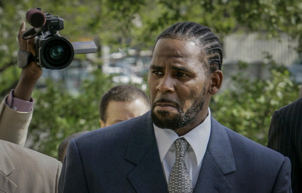 FILE - This photo from Friday May 9, 2008, shows R. Kelly arriving for the first day of jury selection in his child pornography trial at the Cook County Criminal Courthouse in Chicago. On Wednesday, Sept. 15, 2021, prosecutors in Kelly's sex trafficking trial at Brooklyn Federal Court in New York, played video and audio recordings for the jury they say back up allegations he abused women and girls.