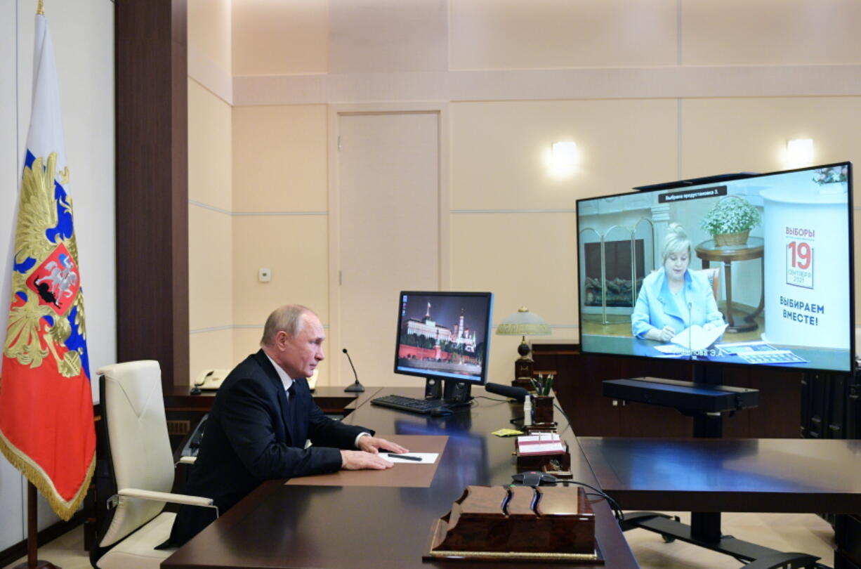 Russian President Vladimir Putin speaks to Ella Pamfilova, head of Russian Central Election Commission, on the screen, during their meeting via video conference at the Novo-Ogaryovo residence outside Moscow, Russia, Monday, Sept. 20, 2021.