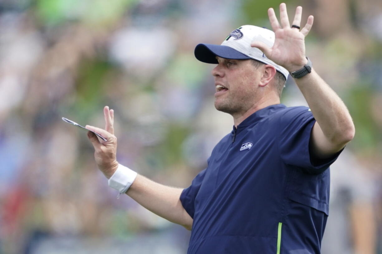 Seattle Seahawks offensive coordinator Shane Waldron calls to players during practice in Renton. Tasked with modernizing Seattle's offense and making Russell Wilson happy, Waldron's system finally gets its unveiling in the opener on Sunday against Indianapolis. (AP Photo/Ted S.