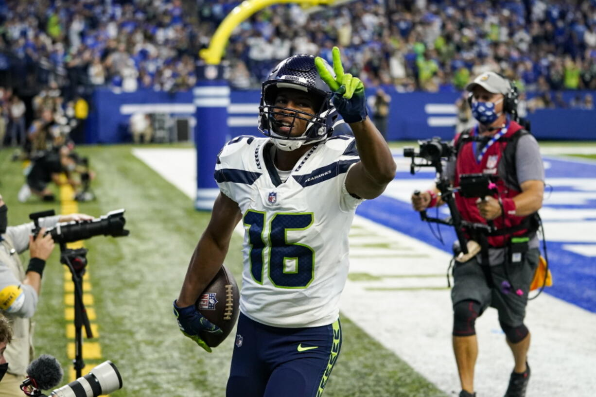 Seattle Seahawks wide receiver Tyler Lockett (16) celebrates after a touchdown against the Indianapolis Colts in the first half of an NFL football game in Indianapolis, Sunday, Sept. 12, 2021.