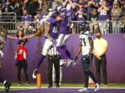 Minnesota Vikings tight end Tyler Conklin (83) celebrates with wide receiver Adam Thielen (19) after scoring a touchdown against the Seattle Seahawks in the first half of an NFL football game in Minneapolis, Sunday, Sept. 26, 2021.