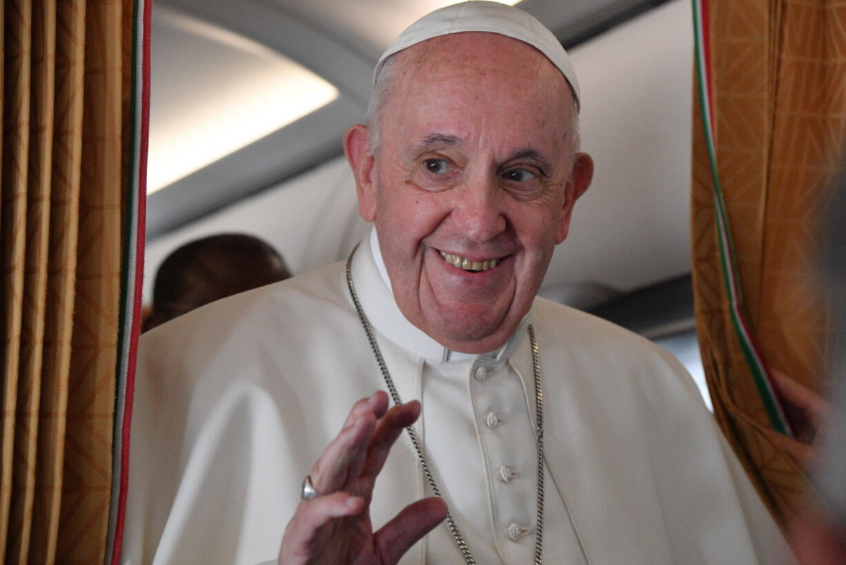 Pope Francis speaks with journalists on board an Alitalia aircraft enroute from Bratislava back to Rome, Wednesday, Sept. 15, 2021 after a four-day pilgrimage to Hungary and Slovakia.