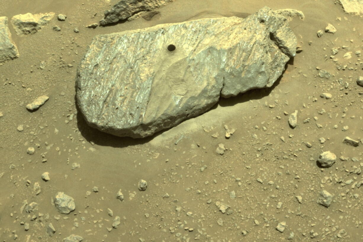 This Sept. 1, 2021 image provided by NASA shows the hole drilled by the Perseverance rover during its second sample-collection attempt in Mars' Jezero Crater.