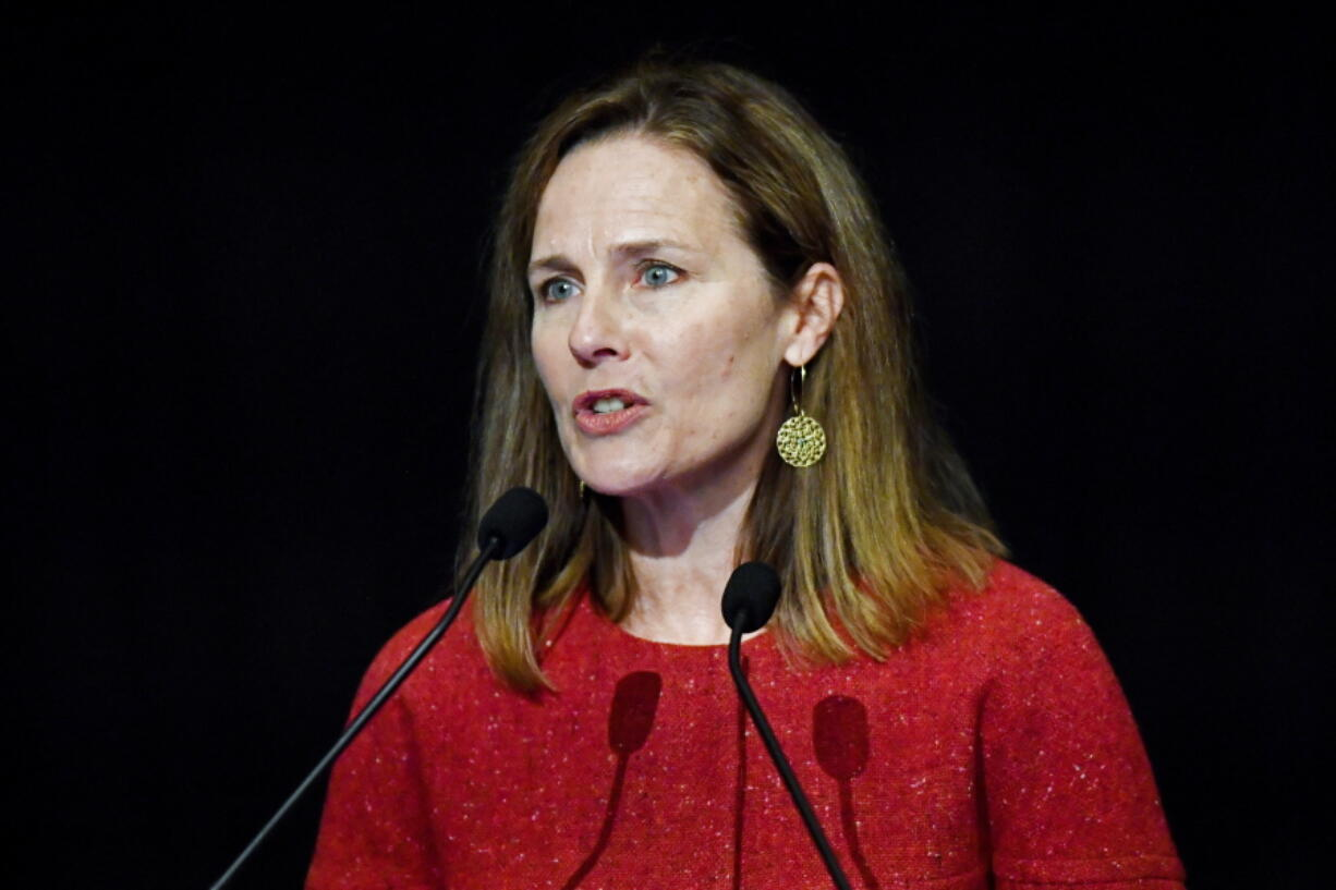 FILE - In this Sept. 12, 2021, file photo U.S. Supreme Court Associate Justice Amy Coney Barrett speaks to an audience at the 30th anniversary of the University of Louisville McConnell Center in Louisville, Ky. Barrett's confirmation was arguably the most political of any member of the court. She was confirmed on a 52-48 vote, the first in modern times with no support from the minority party. (AP Photo/Timothy D.