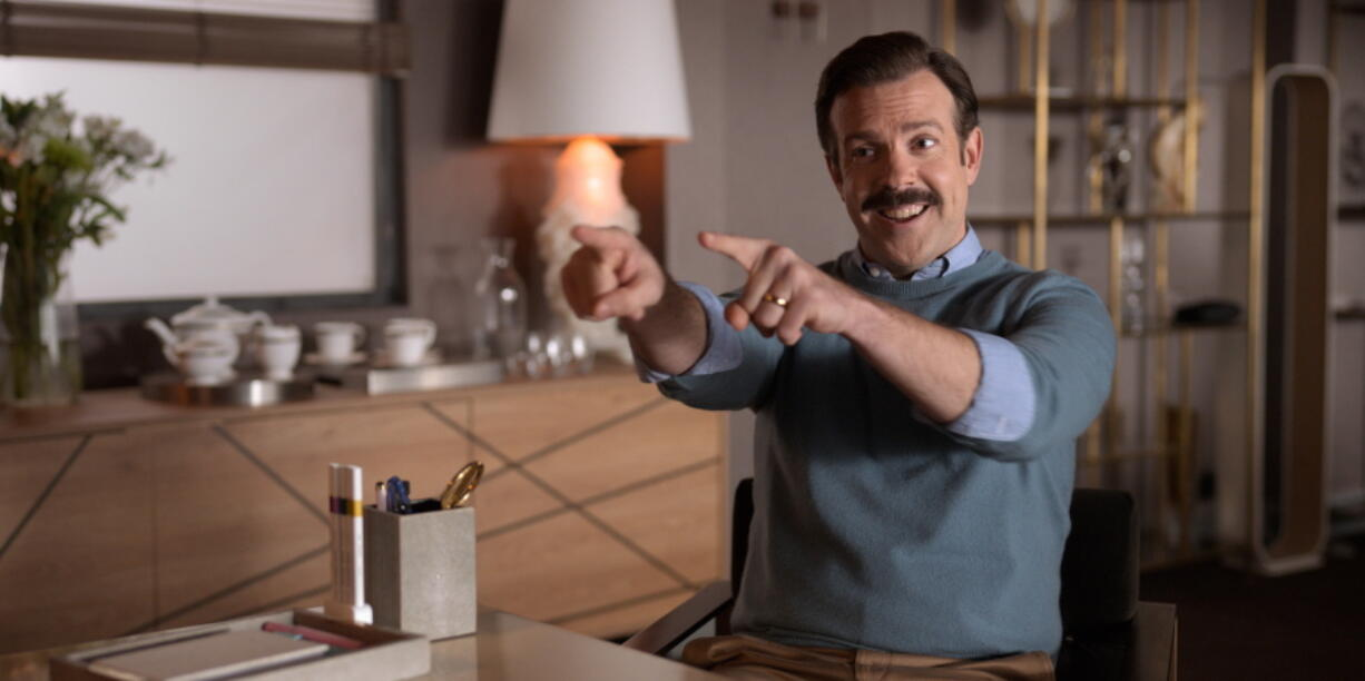 """This image released by Apple TV Plus shows Jason Sudeikis in """"Ted Lasso."""" Sudeikis is nominated for an Emmy Award for outstanding leading actor in a comedy series."""