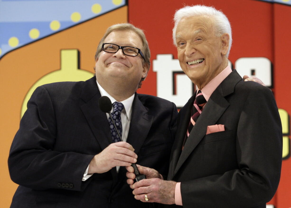 The Price is Right show host, comedian Drew Carey, left, appears with longtime former host Bob Barker at the CBS Studio Center in Los Angeles on March 25, 2009. The longest-running game show in television history is celebrating it's 50th season.