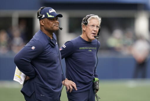 Seattle Seahawks head coach Pete Carroll, right, stands with defensive coordinator Ken Norton Jr., left, stand on the sidelines during Sunday's game against the Tennessee Titans in Seattle.