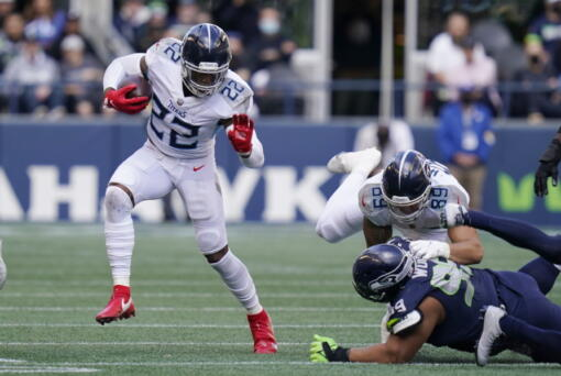 Tennessee Titans running back Derrick Henry (22) rushes against the Seattle Seahawks during the second half of an NFL football game, Sunday, Sept. 19, 2021, in Seattle.