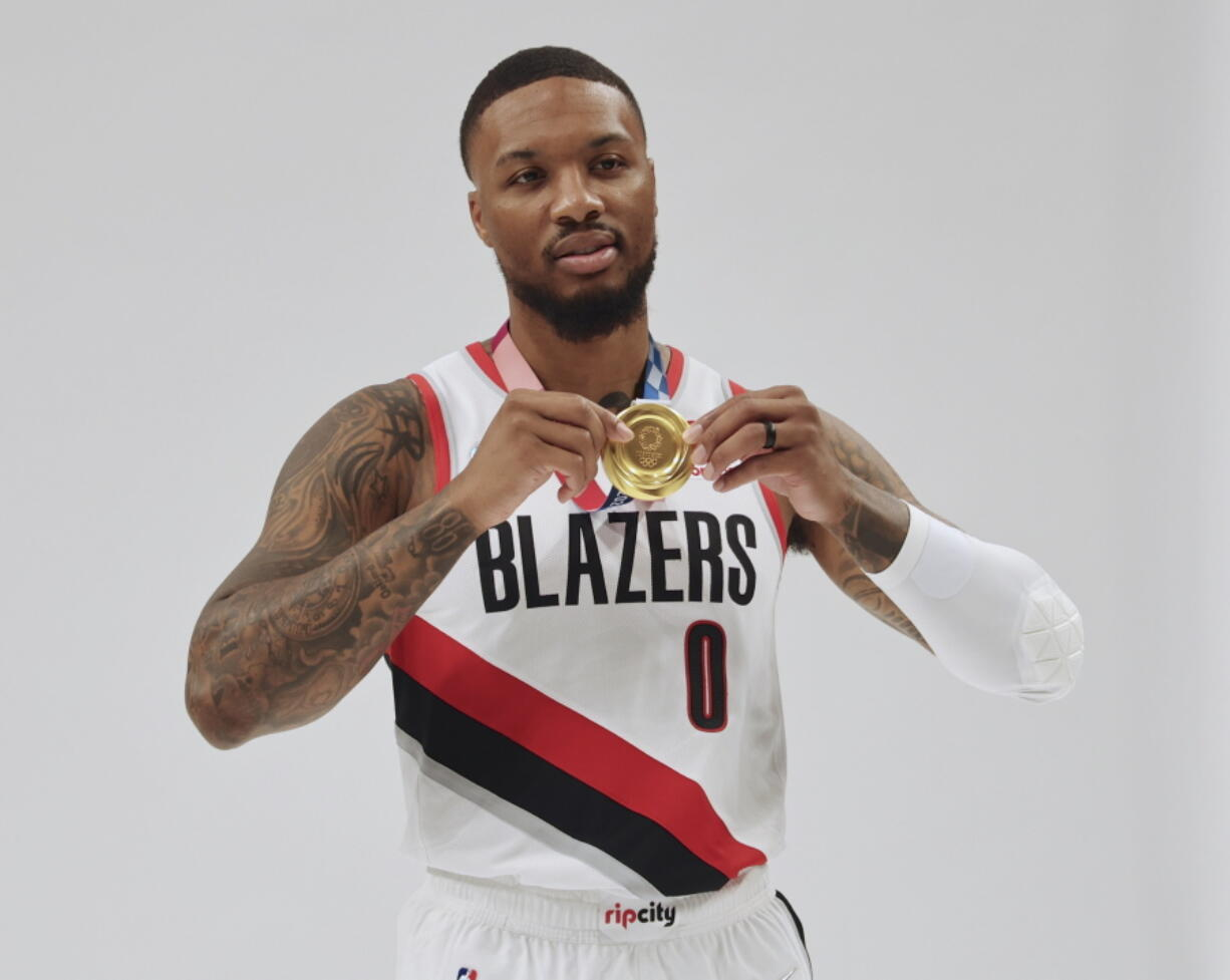 Damian Lillard poses with his Olympic gold medal during the Portland Trail Blazers' Media Day on Monday in Portland, Ore.