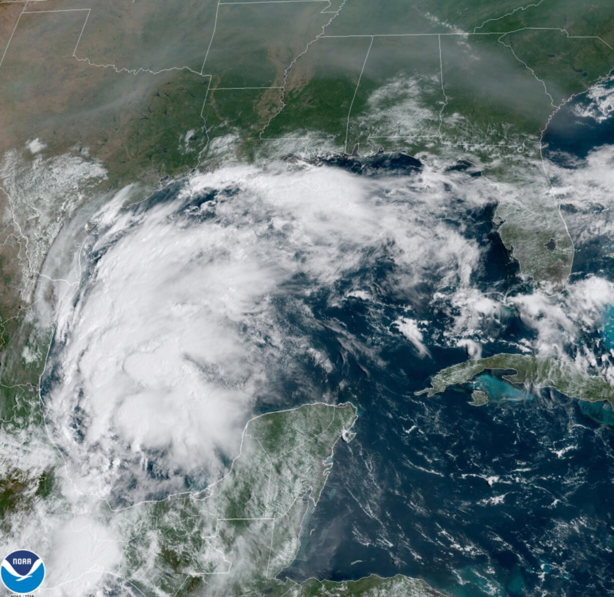 This satellite image provided by NOAA shows Tropical Storm Nicholas in the Gulf of Mexico on Sunday, Sept. 12, 2021. Tropical storm warnings have been issued for coastal Texas and the northeast coast of Mexico. Nicholas is expected to produce storm total rainfall of 5 to 10 inches, with isolated maximum amounts of 15 inches, across portions of coastal Texas into southwest Louisiana Sunday, Sept. 12 through midweek.