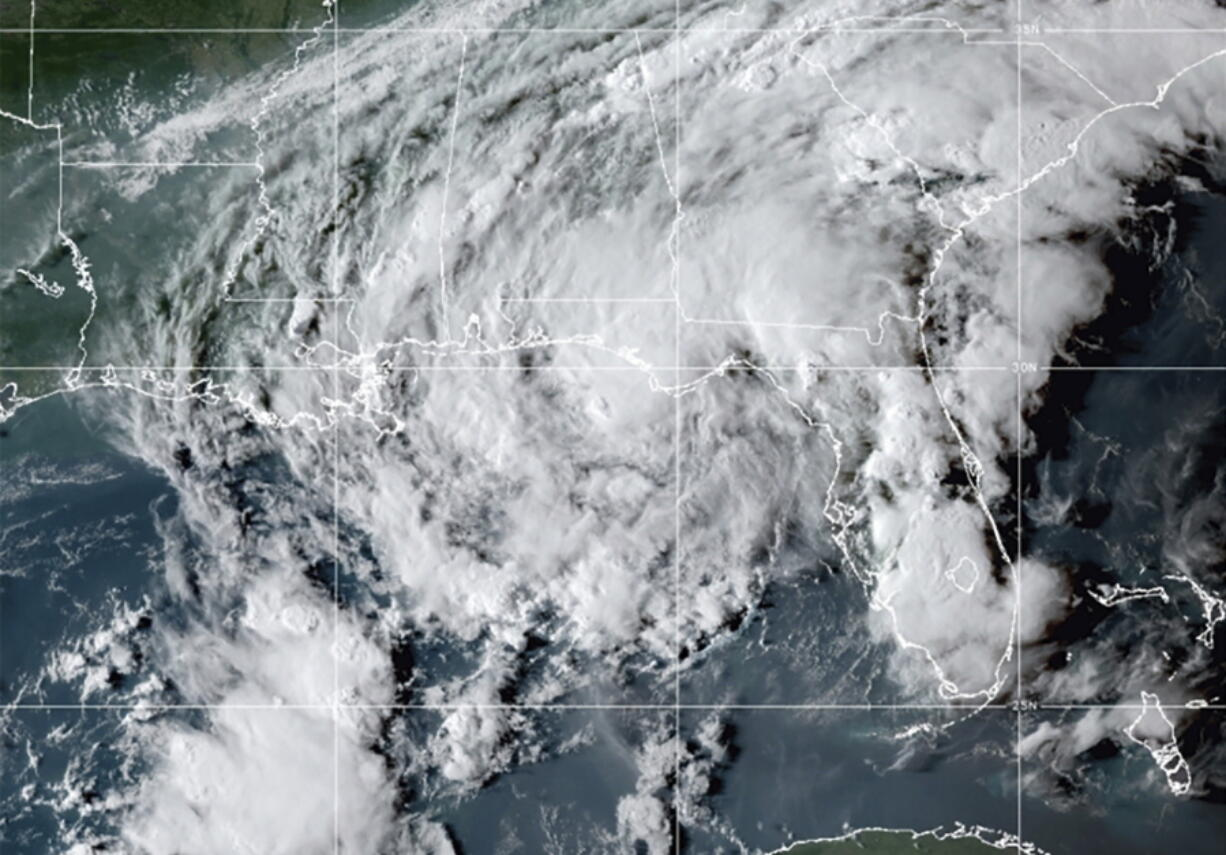 This GOES- East GeoColor satellite image taken Wednesday, Sept. 8, 2021, at 10:30 p.m. EDT., and provided by NOAA, shows Tropical Storm Mindy as it makes landfall on the Florida Panhandle. The storm touched down over St. Vincent Island, about 10 miles (15 km) west southwest of Apalachicola, according to the National Hurricane Center.