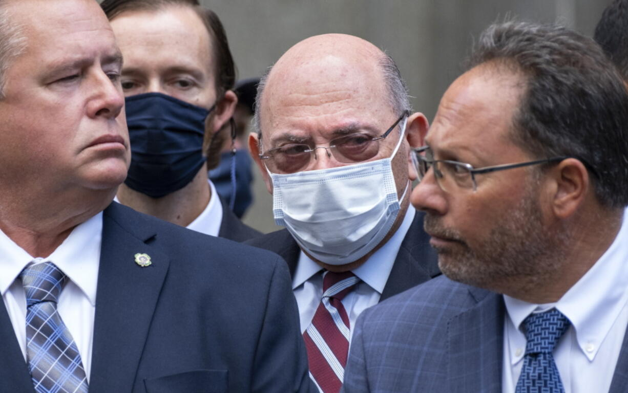 """The Trump Organization's Chief Financial Officer Allen Weisselberg, center, awaits a car after leaving a courtroom appearance in New York, Monday, Sept. 20, 2021. Donald Trump's company and its longtime finance chief were charged Thursday in what a prosecutor called a """"sweeping and audacious"""" tax fraud scheme that saw the Trump executive allegedly receive more than $1.7 million in off-the-books compensation, including apartment rent, car payments and school tuition."""