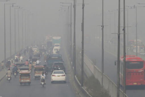 FILE - In this Wednesday, Nov. 11, 2020 file photo, vehicles drive on a highway as smog envelops the area of Lahore, Pakistan. The World Health Organization said Wednesday Sept. 22, 2021, the negative health impacts of poor air quality kick in at lower levels than it previously thought, announcing revisions to its guidelines on air quality that set a higher bar for policymakers in a world where 90 percent of people already live in areas with one particularly harmful type of pollutant. (AP Photo/K.M.