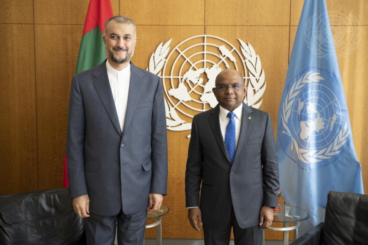 In this photo provided by the United Nations, United Nations General Assembly President Abdulla Shahid of Maldives, right, meets with Iran's Foreign Minister Hossein Amir Abdollahian, during 76th session of the United Nations General Assembly, Thursday, Sept. 23, 2021, at UN headquarters.
