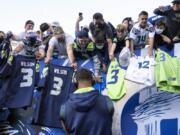 Fans attending most pro sporting events in Seattle will soon be required to show proof they've been vaccinated against COVID-19 or that they've tested negative for the virus. The NFL's Seahawks, MLS's Sounders, NHL's Kraken and the University of Washington all announced updated policies Tuesday, Sept. 7, 2021, for fans attending games this season.