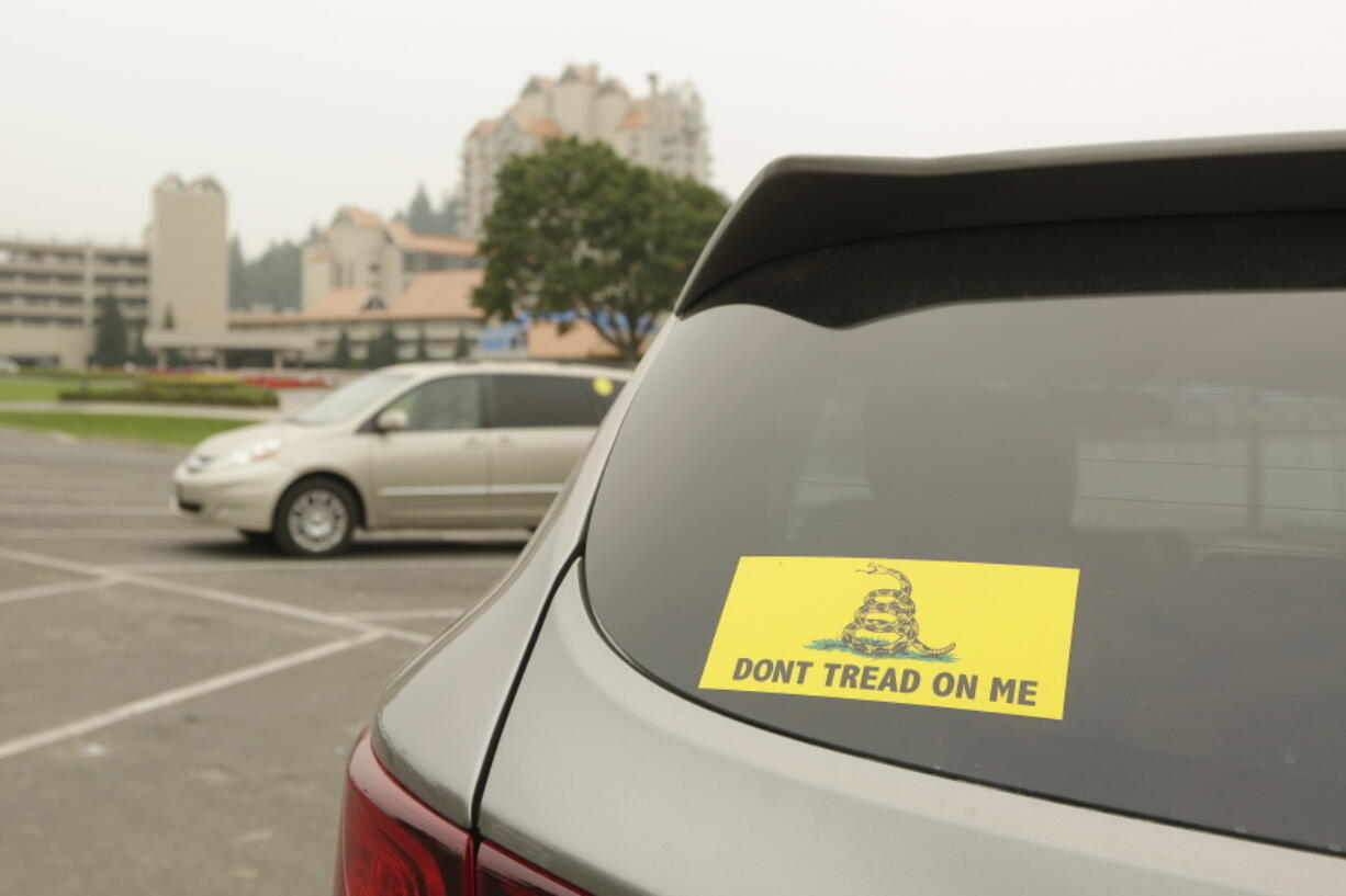 A vehicle with a Gadsden flag sticker is parked in the lot at Independence Point, Friday, Sept. 10, 2021, in Coeur d'Alene, Idaho.