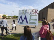 Protesters gather in front of Lakeshore High School, in Stevensville, Mich., Tuesday. Sept. 7, 2021, to protest recent COVID-19 mask mandates.